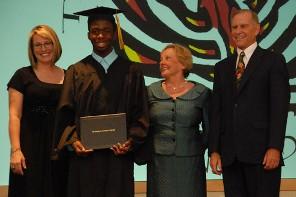 Director Harsin with a Davidson Academy graduate and Bob and Jan Davidson