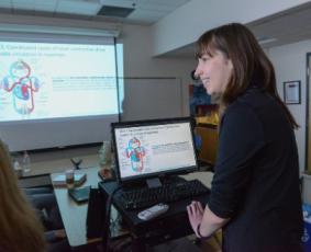 A Davidson Academy teacher at the projector