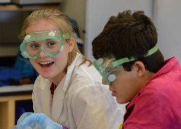 Students wearing goggles in a lab