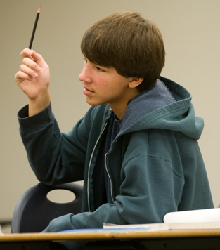 A gifted student raising his hand in a Davidson Academy class
