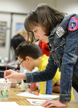 A Davidson Academy student working on an art project