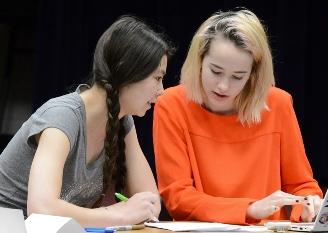 A Davidson Academy teacher assisting a student