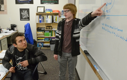 A gifted student pointing at a math diagram as another Davidson Academy student looks on
