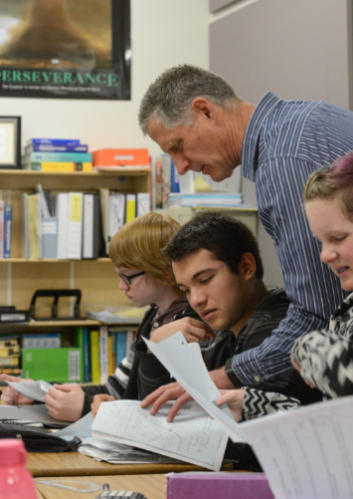 A Davidson Academy teacher assisting students in the classroom