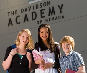 Profoundly gifted students smiling as they stand in front of the Davidson Academy building