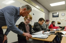 An educator assisting profoundly gifted students in the classroom