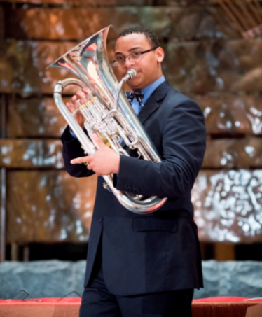 A Davidson Fellow playing a brass instrument at an award ceremony