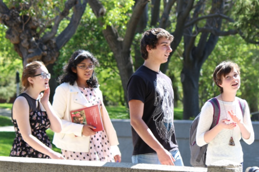 a number of gifted students walking and chatting outside