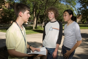 A number of gifted students interacting outside of a school