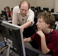 a THINK instructor assisting a gifted student at the computer
