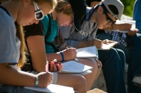 gifted students concentrating and studying outside
