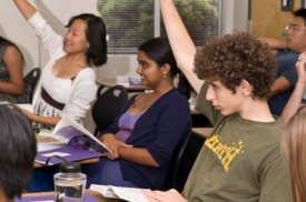 gifted students raising their hands in a classroom